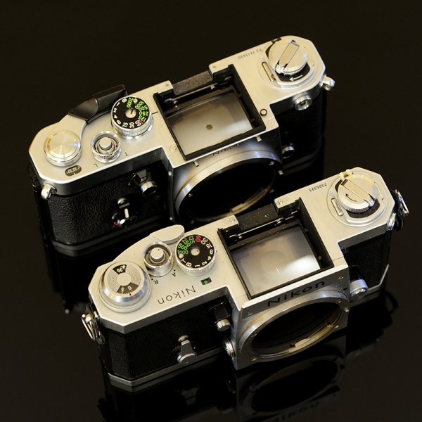The F and F2 seem more similar than different-especially with their metering heads removed. Some components are interchangeable, like the focus screens.