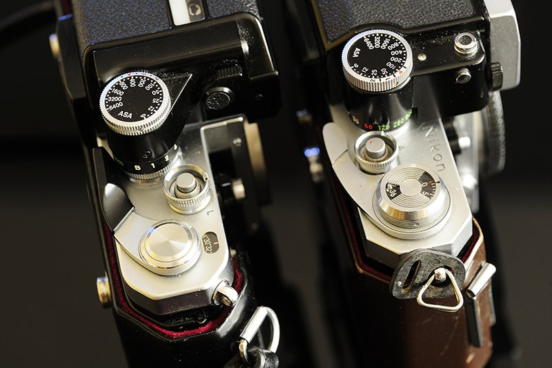 The Nikon F's FTn head (shown on left) is larger and distinctly different than the F2's smaller DP-2 head shown on right.