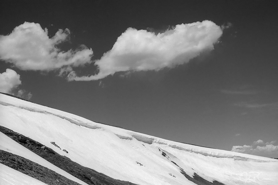 frame 05: Clouds, Cornice and Snowfield, Old Fall River Road, RMNP, Colorado. Pan F50+, Nikkor 50mm f1.4D. 1/200 @ f8; Nikkor Y48 yellow filter, DDX by the book: 1:4 @ 68°.